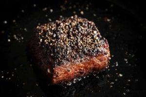 A seared steak au poivre.