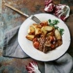 A plate of boeuf Bourguignon with roasted potatoes