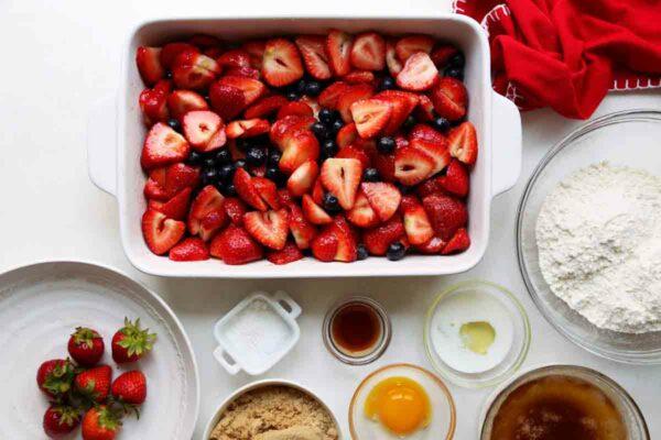 Letting the fruit macerate for Joy the Baker's Strawberry-Blueberry Cobbler