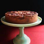 Super moist apple cake on a jadeite cake stand.